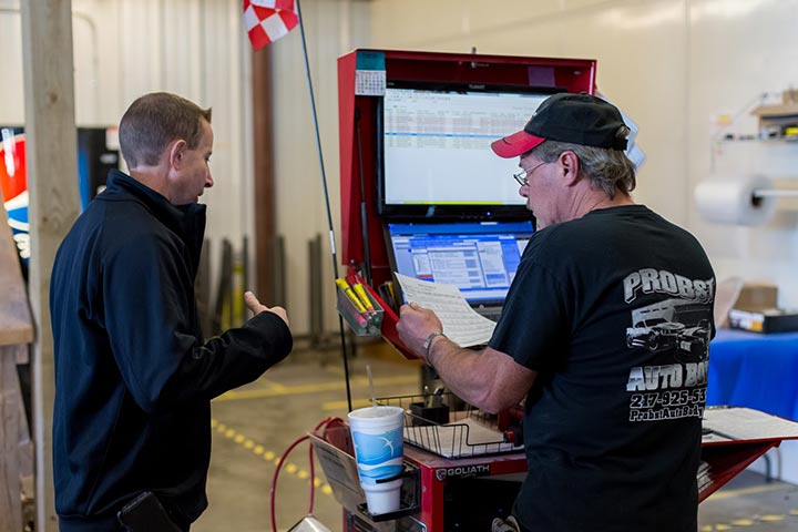 Toby and a technician creating a blueprint